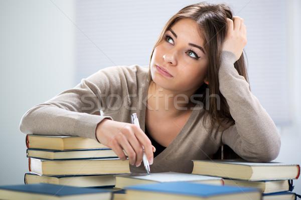 Student girl thinking Stock photo © MilanMarkovic78