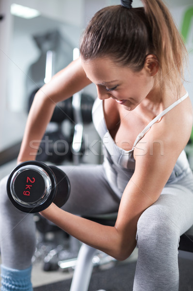 Biceps exercice cute jeune femme fitness Photo stock © MilanMarkovic78