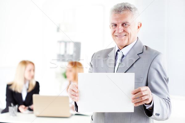 старший бизнесмен счастливым визитной карточкой служба Сток-фото © MilanMarkovic78