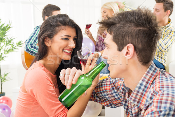 Cheerful Couple At House Party Stock photo © MilanMarkovic78
