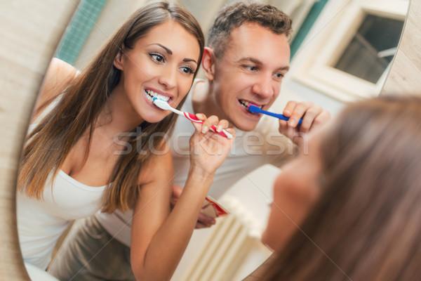 Couple Brushing Teeth  Stock photo © MilanMarkovic78