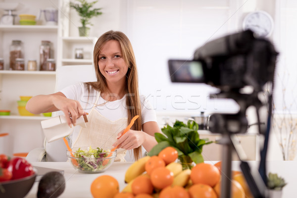 Attractive Blogger Girl Making Video For You Stock photo © MilanMarkovic78