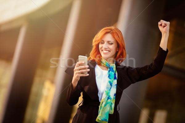 生まれる 成功 笑みを浮かべて 女性実業家 スマートフォン オフィス ストックフォト © MilanMarkovic78
