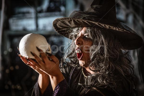 Witch Tells Magic Words To Skull Stock photo © MilanMarkovic78