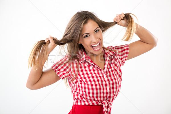 Vicces lány gyönyörű fiatal nő szórakozás tart Stock fotó © MilanMarkovic78
