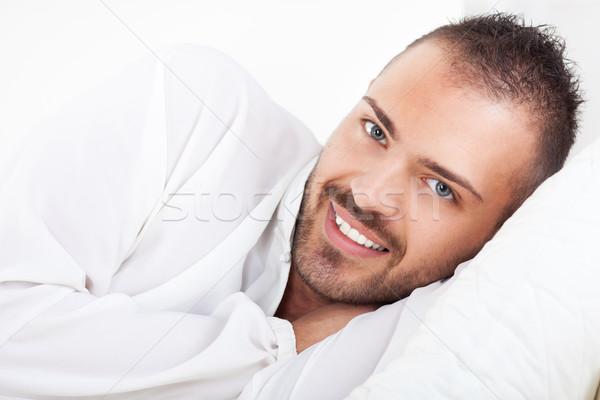 Szabadidős tevékenység gyönyörű fiatalember pihen otthon ágy Stock fotó © MilanMarkovic78
