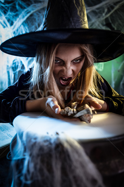 Young Witch Is Cooking With Magic Bouns Stock photo © MilanMarkovic78