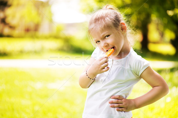 Little Girl With Lollipop Stock photo © MilanMarkovic78