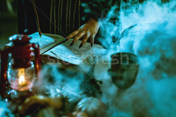 Kéz mágikus könyv közelkép fekete körmök Stock fotó © MilanMarkovic78