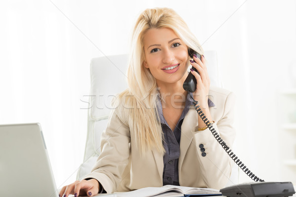 Blonde Businesswoman Phoning In The Office Stock photo © MilanMarkovic78