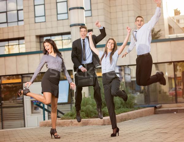 Baan groep jonge zakenlieden springen bedrijf Stockfoto © MilanMarkovic78