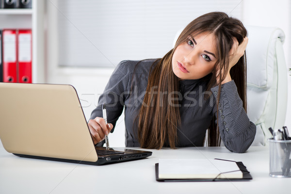 Stressful Businesswoman in the office Stock photo © MilanMarkovic78