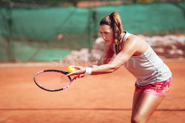 Female Tennis Player Serving Stock photo © MilanMarkovic78