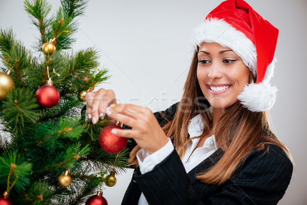 Businesswoman Decorating Christmas Tree Stock photo © MilanMarkovic78