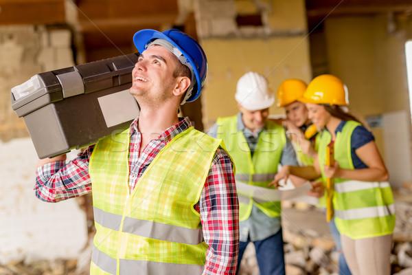 Ricostruzione sorridere giovani elettricista casco Foto d'archivio © MilanMarkovic78