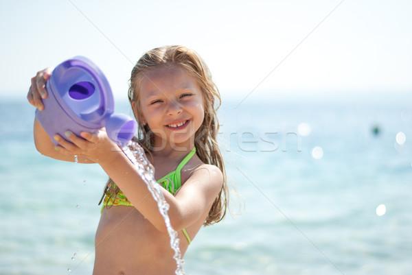 Little girl at beach Stock photo © MilanMarkovic78