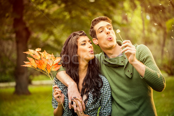 Couple Blowing Dandelion Stock photo © MilanMarkovic78