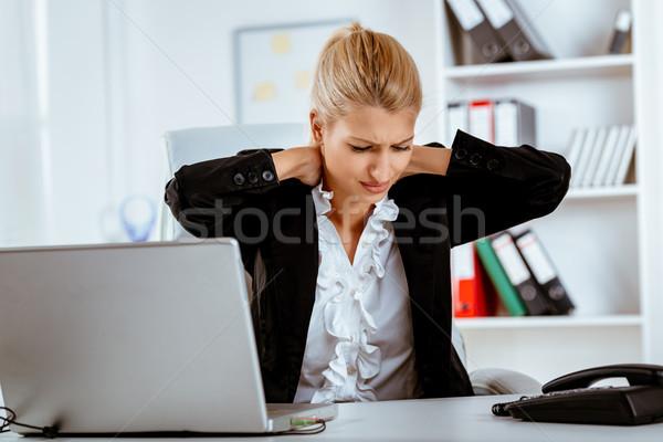 Tired Businesswoman Stock photo © MilanMarkovic78
