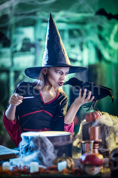 Young Witch Whispers To Blackbird Stock photo © MilanMarkovic78