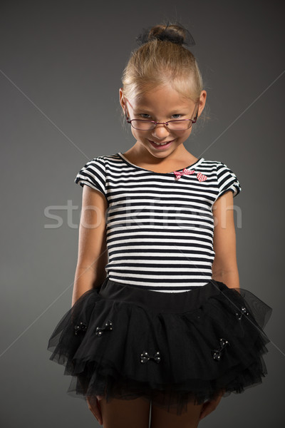 Küçük kız güzel gülen poz stüdyo gri Stok fotoğraf © MilanMarkovic78