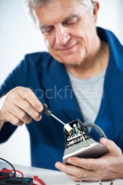 Javít öreg vasaló idős felnőtt villanyszerelő Stock fotó © MilanMarkovic78
