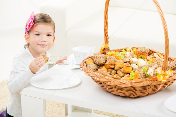 Cute Little Girl With Pastry Stock photo © MilanMarkovic78