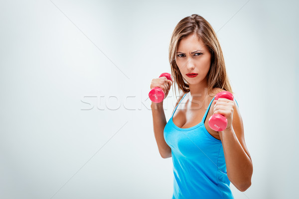Fitnes Woman With Dumbbells Stock photo © MilanMarkovic78