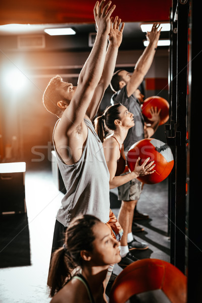 Motivado éxito grupo jóvenes muscular amigos Foto stock © MilanMarkovic78
