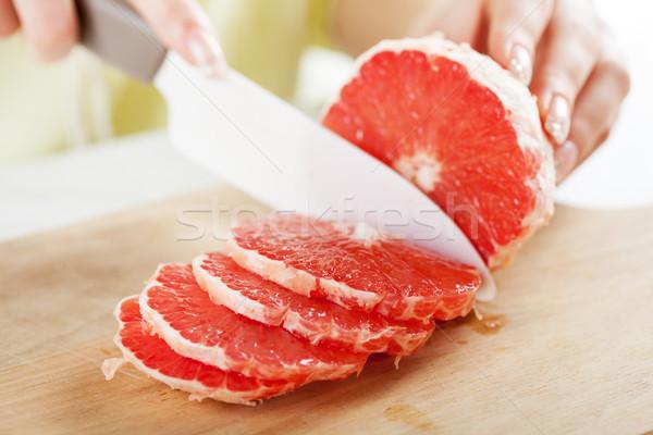 красный грейпфрут женщины рук Сток-фото © MilanMarkovic78