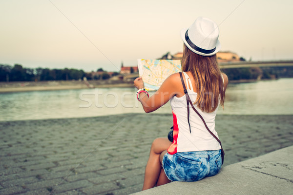 Woman Tourist With Map Stock photo © MilanMarkovic78