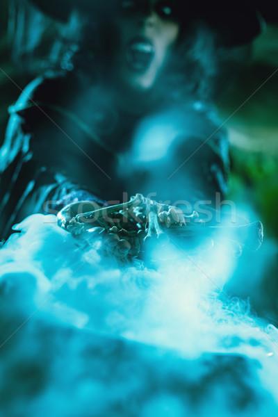 Ossos mãos acima água Foto stock © MilanMarkovic78