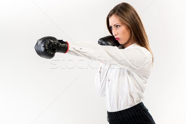 Mujer de negocios boxeo grave guantes de boxeo blanco fondo blanco Foto stock © MilanMarkovic78