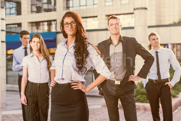 Jeunes réussi belle femme d'affaires verres permanent Photo stock © MilanMarkovic78