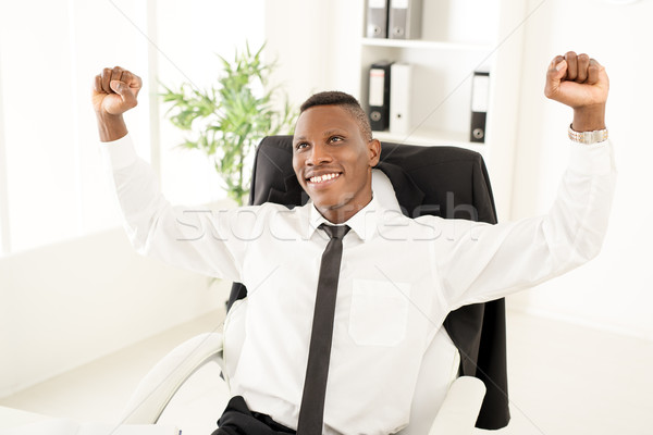 Erfolgreich Geschäftsmann african Erfolg angehoben Stock foto © MilanMarkovic78