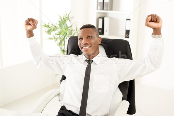 Sikeres üzletember afrikai ünnepel siker kiemelt Stock fotó © MilanMarkovic78