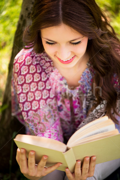Girl with a book in the park Stock photo © MilanMarkovic78