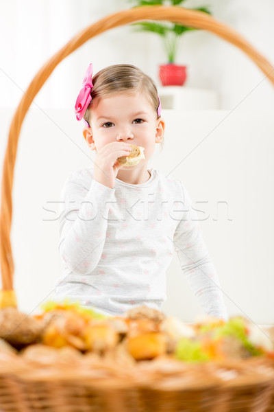 A Little Girl Eating Pastry Stock photo © MilanMarkovic78