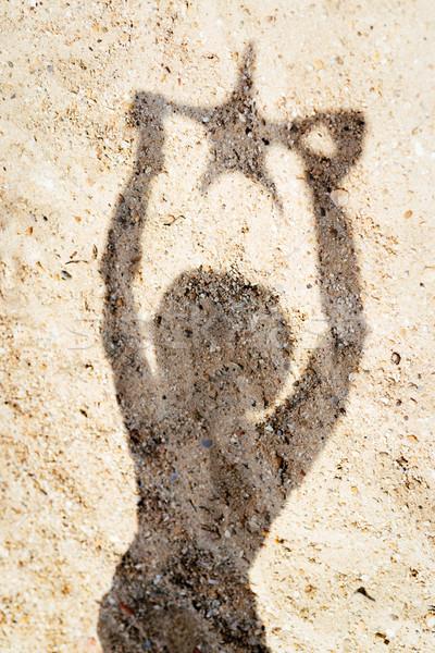 Gölge kız denizyıldızı kum kadın Stok fotoğraf © MilanMarkovic78