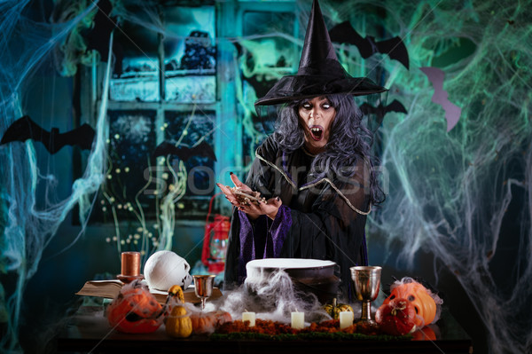 Witch Is Cooking Magic Potion With Bones Stock photo © MilanMarkovic78