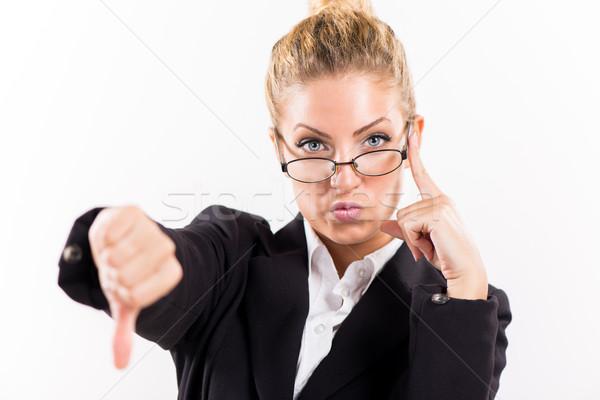 Businesswoman showing thumbs down Stock photo © MilanMarkovic78