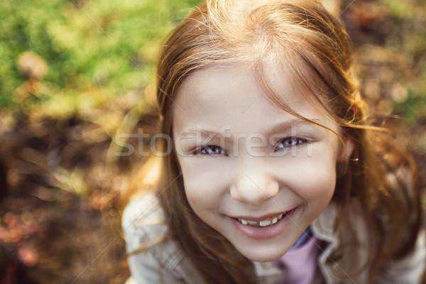 Nina ojos azules primer plano niñas cara sonrisa Foto stock © MilanMarkovic78