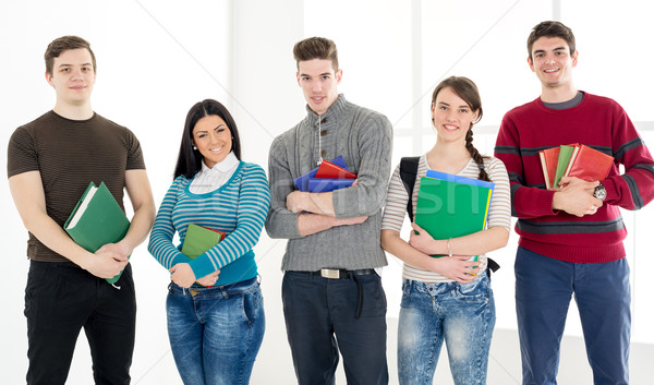 Group Of Smiling Students With Books Stock photo © MilanMarkovic78
