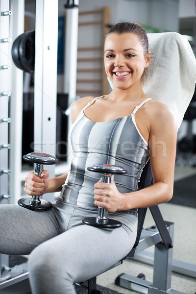 Young woman relaxing in a fitness center Stock photo © MilanMarkovic78