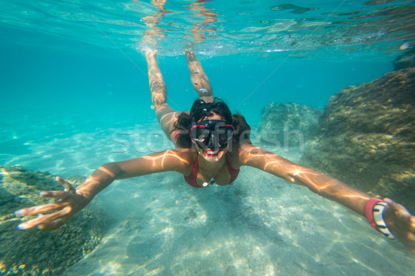 Girl Snorkeling Stock photo © MilanMarkovic78