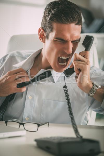 öfkeli işadamı genç oturma ofis Stok fotoğraf © MilanMarkovic78