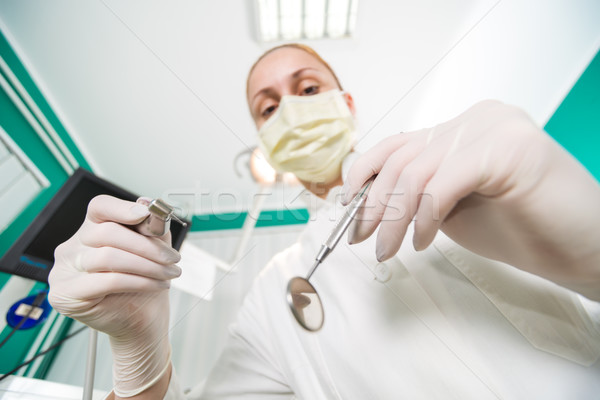 Dentist Working From Perspective Of Patient Stock photo © MilanMarkovic78