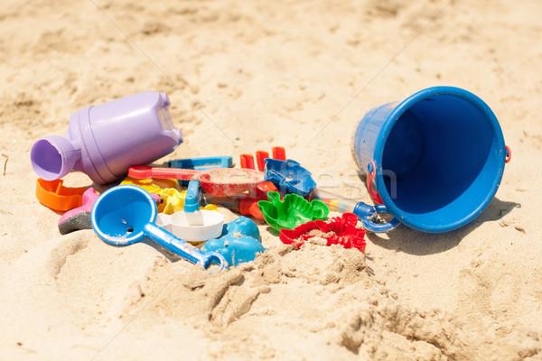 Toys in the sand Stock photo © MilanMarkovic78