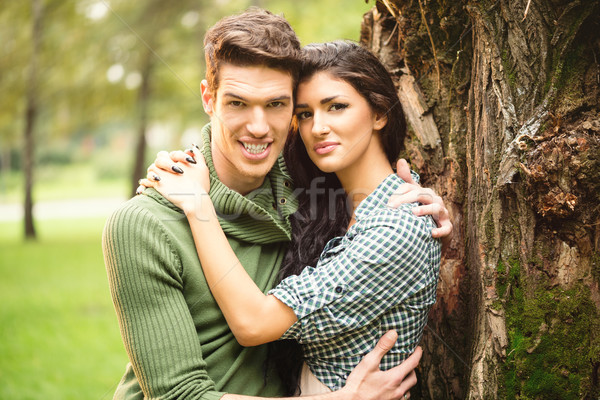 Embraced Couple Beside The Tree Stock photo © MilanMarkovic78