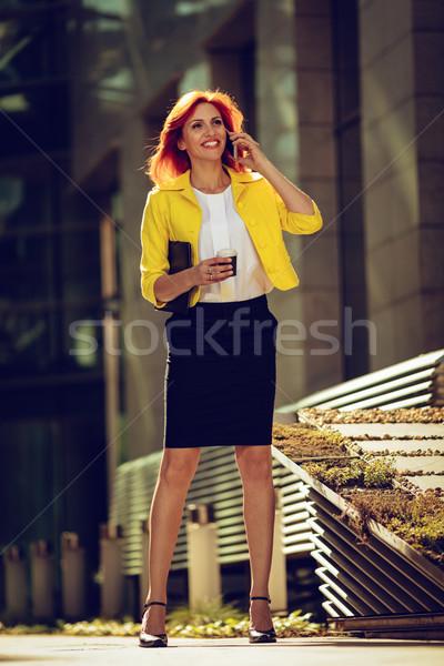 生まれる 成功 笑みを浮かべて 成功した 女性実業家 スマートフォン ストックフォト © MilanMarkovic78