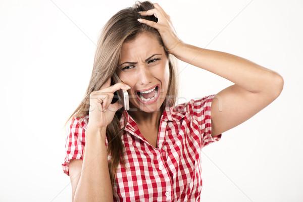 悪い知らせ 美しい 若い女性 話し 電話 問題 ストックフォト © MilanMarkovic78